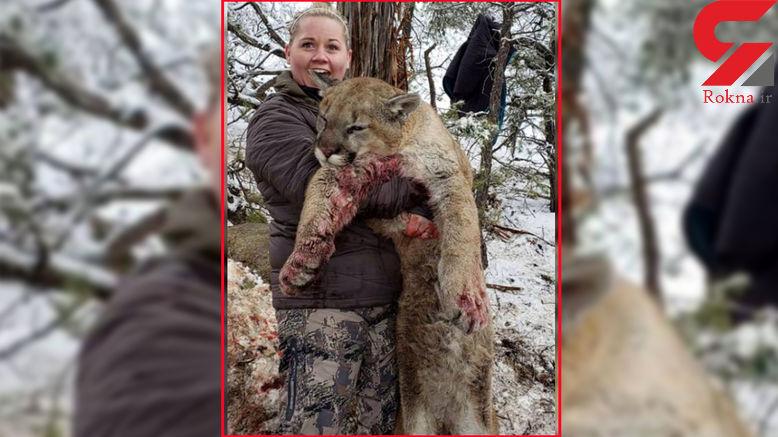 عکس جنجالی و دردناک زن شکارچی با شیر کوهی