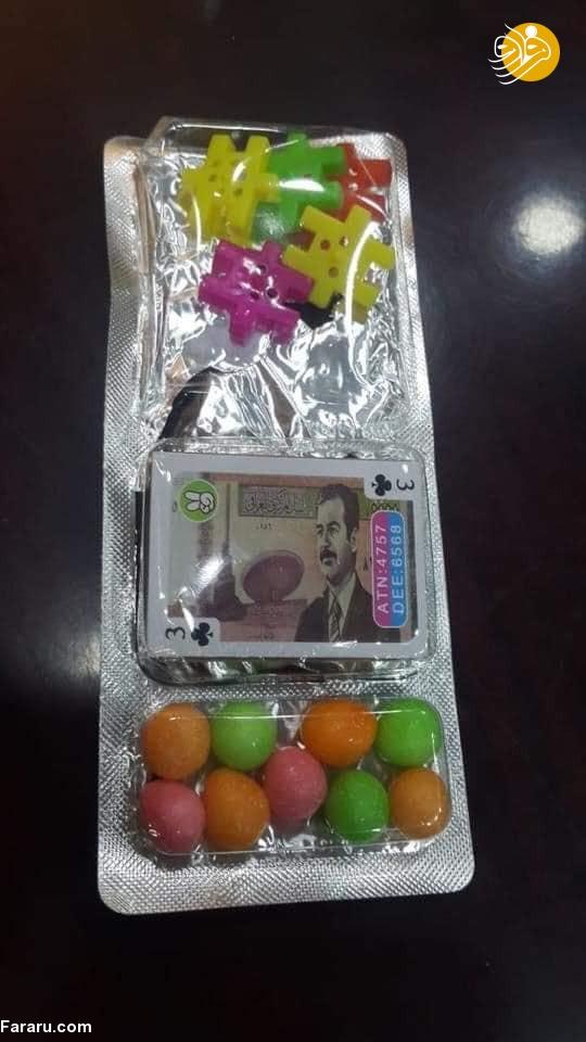توزیع شیرینی با عکس صدام حسین +عکس