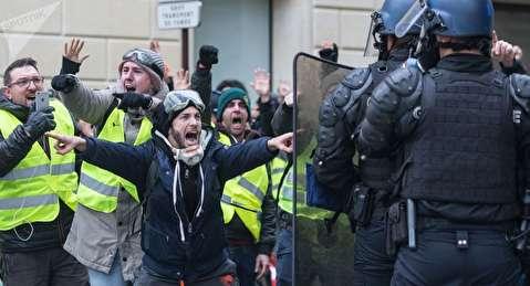چپ کردن ماشین لوکس به دست معترضان فرانسوی