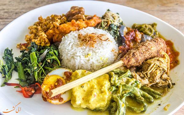 معروف ترین غذاهای بالی؛ سفری به این جزیره در اندونزی {hendevaneh.com}{سایتهندوانه}معروف ترین غذاهای بالی؛ سفری به این جزیره در اندونزی - 233954 582 - معروف ترین غذاهای بالی؛ سفری به این جزیره در اندونزی