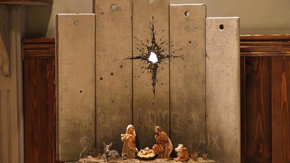 بنکسی در فلسطین چه میکند؟ +عکس