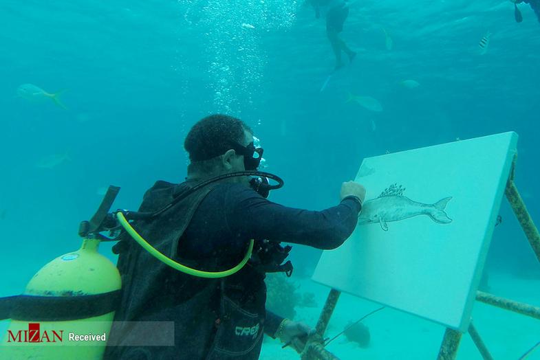 نقاشی کشیدن هنرمند کوبایی در اعماق آب+تصاویر