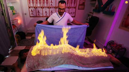 ماساژ بدن مشتریان با آتش+عکس