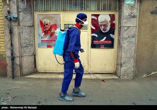 ضدعفونی خیابانهای قم توسط حشدالشعبی +عکس