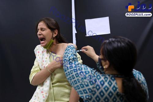 واکنش عجیب یک زن به واکسن کرونا+عکس