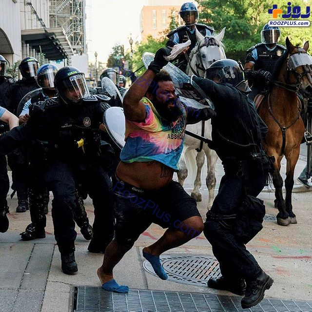 جنگ تن به تن پلیس و معترض در آمریکا+عکس