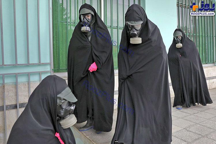 تدفین جنازه یک قربانی کرونا با ماسک شیمیایی+عکس