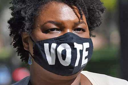 بایدن پیروزی در جرجیا را مدیون یک زن است+عکس