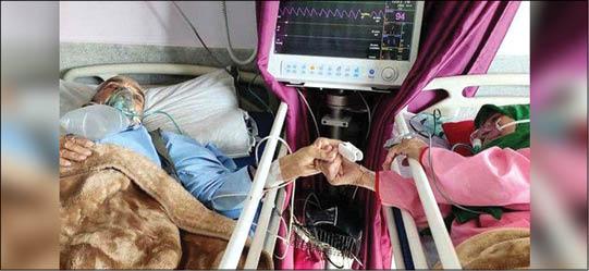 عکس تکان دهنده از زوج کرونایی در بیمارستان +عکس