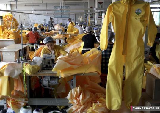 تولید لباس ایمنی در کارخانه صنایع لیکلند در شهر ویفانگ استان شاندونگ در کشور چین